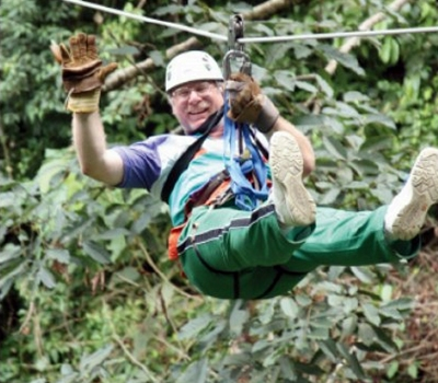 Bob Sonnenblick zip-lining through the rainforest in Costa Rica.