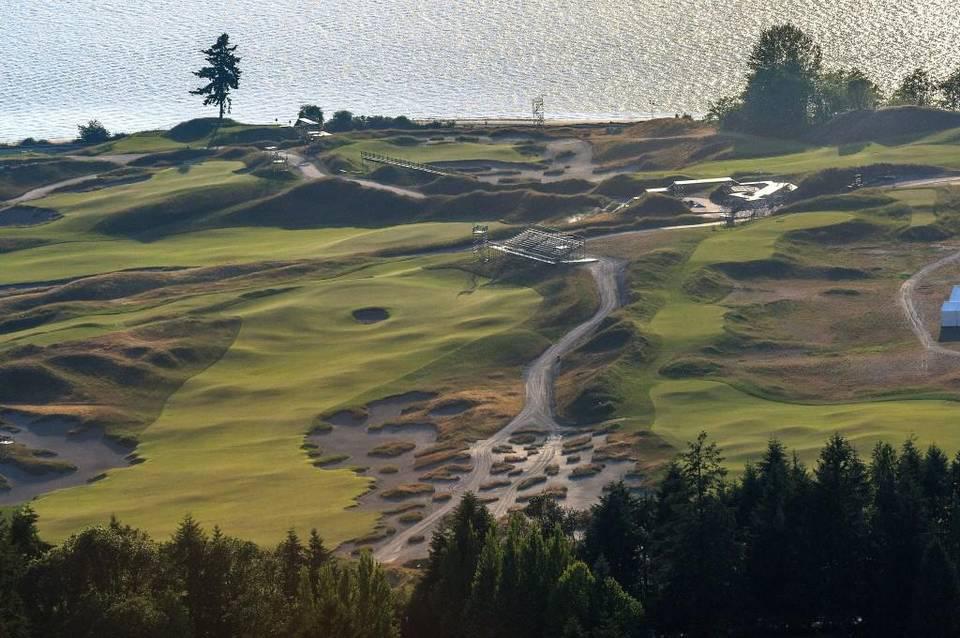 The now legendary lone fir stands out amid the rolling landscape of the links style golf course at Chambers Bay. An 18-hole golf course and a large resort-hotel are no longer planned for Chambers Bay in University Place. Instead, Pierce County officials have asked the California developer behind the project for a smaller development. Dean J. Koepfler Staff file
